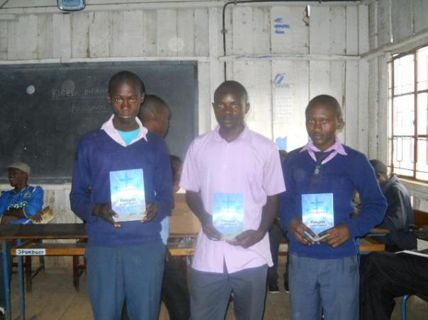 Happy students upon recieving books by the K.i.f team